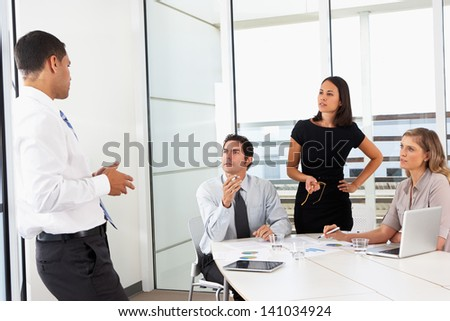 Group Of Businesspeople Meeting In Office - stock photo