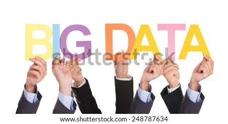 Group Of Businesspeople Showing Big Data Concept Over White Background - stock photo