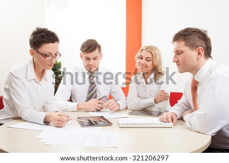 Group of businesspeople sitting and working together