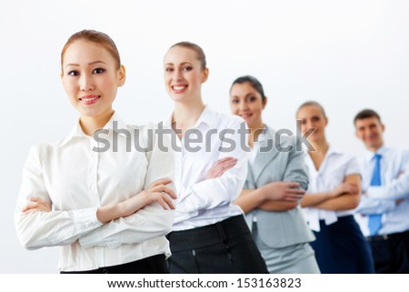 Group of businesspeople smiling standing with arms crossed