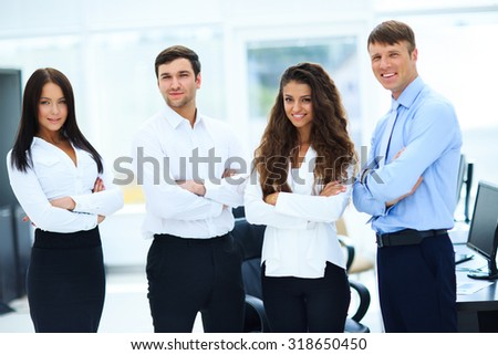 group of businesspeople standing together in office