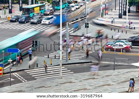 Group of busy people crossing the street ,Shenzhen city, Guangdong province,China. - stock photo