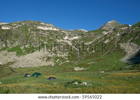 Group of camping tents in mountain wally, travel background.