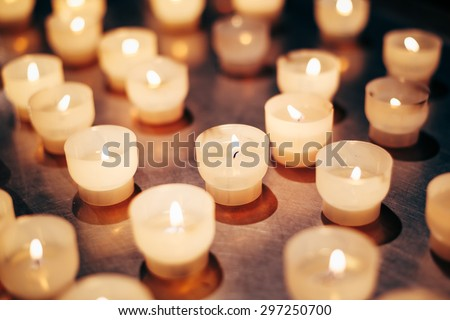 Group Of Candles In Church. Candles Light Background. Candle Flame At Night. - stock photo