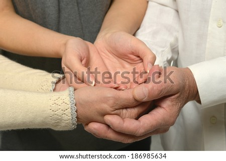 Group of caring hands closeup isolated on white background