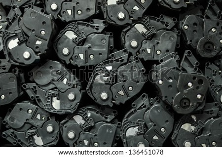 Group of cartridges for laser printers background - stock photo