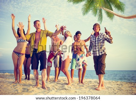 Group of Casual People Partying on a Beach - stock photo