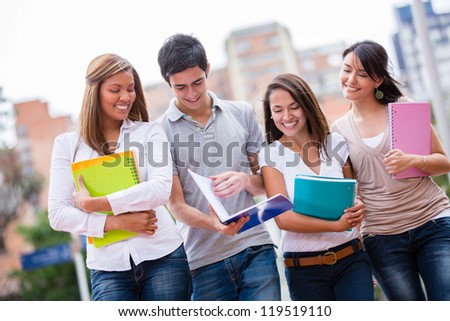Group of casual students walking and looking happy - stock photo