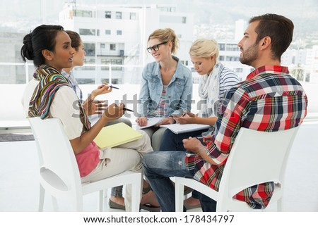 Group of casual young people in meeting at office