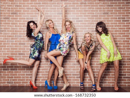 Group of cheerful beautiful woman on brick background. Bachelorette. - stock photo