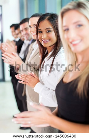 group of cheerful business team applauding - stock photo