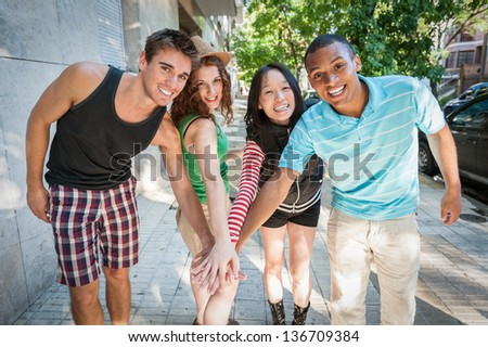 Group of cheerful friends. Multi ethnic. - stock photo