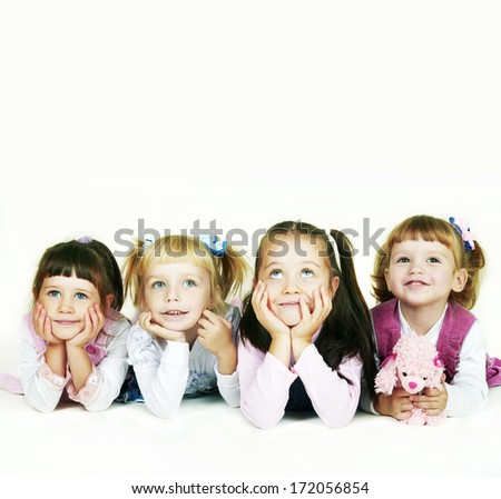 Group of cheerful little girls on a white background - stock photo