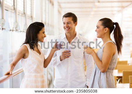 group of cheerful people celebrating at restaurant - stock photo