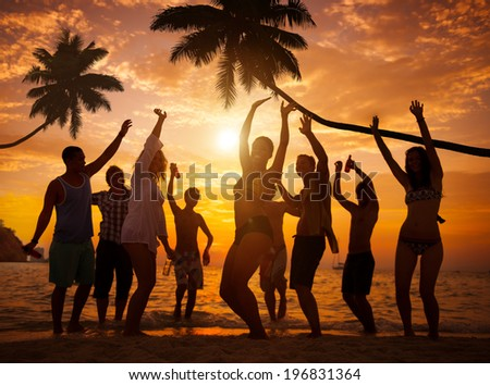 Group of Cheerful People Partying on a Beach - stock photo