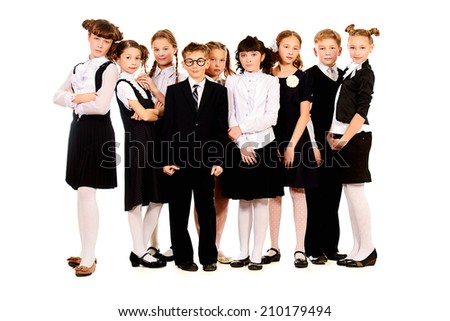 Group of cheerful schoolchildren standing together. Full length portrait. Isolated over white. - stock photo