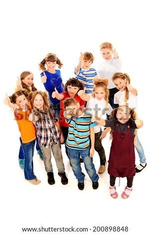 Group of cheerful schoolchildren standing together. Isolated over white. - stock photo