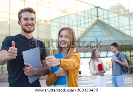 Group of cheerful student show education success thumb up  - stock photo