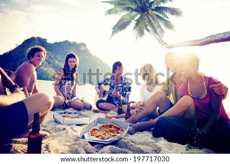 Group of Cheerful Young People Relaxing on a Beach - stock photo