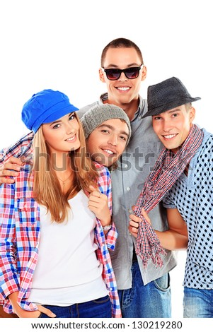 Group of cheerful young people standing together. Friendship. Isolated over white.