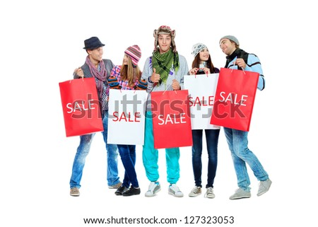 Group of cheerful young people with shopping bags. Isolated over white background.
