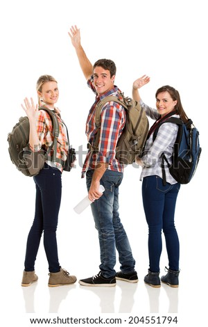 group of cheerful young tourists waving goodbye isolated on white - stock photo