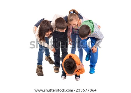 Group of children bullying an isolated child - stock photo