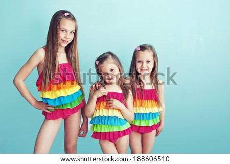Group of Children Dressed in Fashion Swimsuits