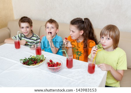 group of children drinking juice