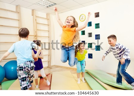 Group of children enjoying gym class - stock photo