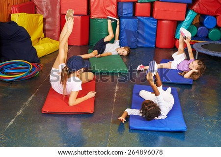 Group of children exercising in physical education in preschool - stock photo