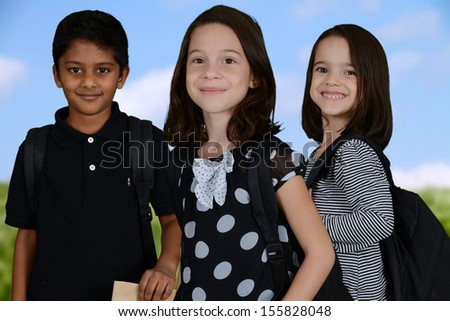 Group of children going to their school - stock photo