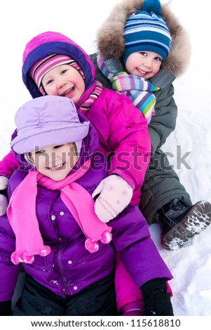 Group of children having fun in winter time - stock photo