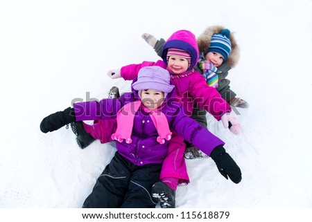 Group of children having fun in winter time
