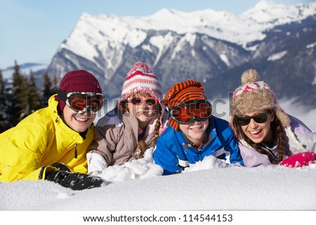 Group Of Children Having Fun On Ski Holiday In Mountains