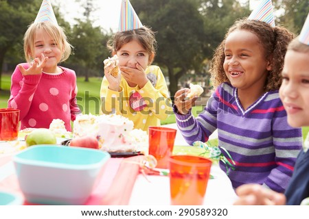 Group Of Children Having Outdoor Birthday Party - stock photo