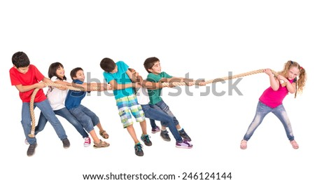 Group of children in a rope-pulling contest against just one strong girl - stock photo