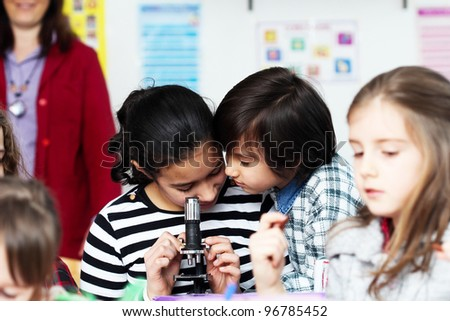 Group of children in classroom - stock photo