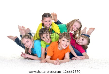 group of children in colorful t-shirts playing together on white background - stock photo