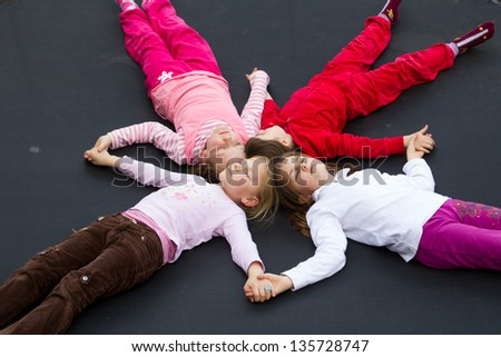 Group of children laying down