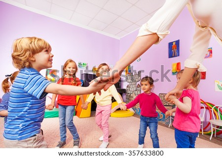 Group of children play roundelay view from bellow - stock photo