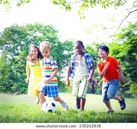 Group of Children Playing Football Concept - stock photo