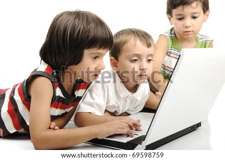 Group of children playing on white laptop together. Isolated on white. - stock photo