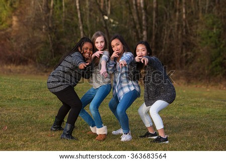 Group of children posing together for girl power - stock photo