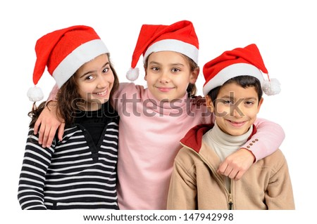 Group of children posing with Santa's hat isolated in white