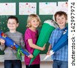 Group of children presents their school project in front of class - stock photo