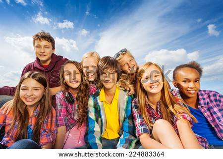 Group of children sitting together and smile