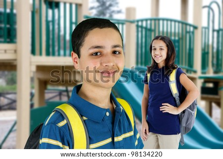 Group of children standing in front of the playground - stock photo