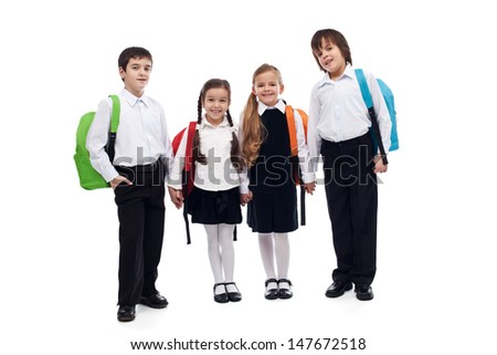 Group of children with colorful backpacks holding hands - back to school concept - stock photo
