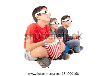 Group of children with 3d glasses and popcorn - stock photo